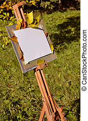 White canvas in a city park - Isolated empty canvas and...