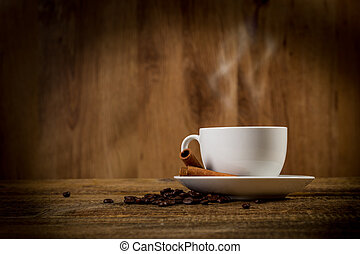 White cap of arabic coffee with beans and cinnamon