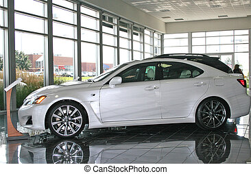 White Car in Showroom - A white car is on display inside a...