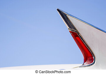 white car tail fin with red light