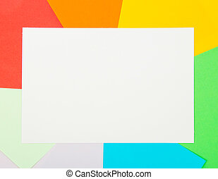 White card on color sheets of paper. Background