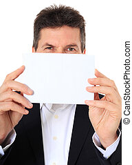White card - Attractive middle-aged man holding blank white...