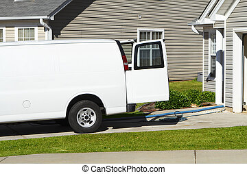 Generic professional carpet & upholstery cleaning service van with hoses coming out the back of the vehicle. In a typical American residential subdivision.