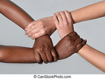 white Caucasian female and black African American hands...