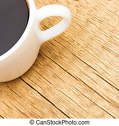 White ceramic coffee cup on wooden table - view from top - 1...