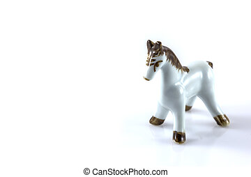 white ceramic figurine of a horse