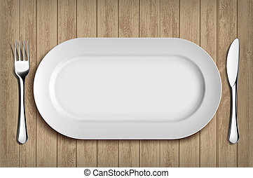 White ceramic plate, fork and knife on wooden table. Menu background.