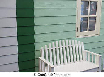 white chair and green wall