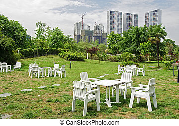 white chair and table on green lawn