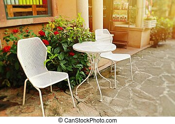 white chair in front of coffee shop