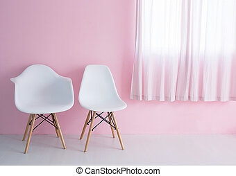 White chair over pink wall in the hipster interior modern room.