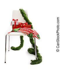 White chair with gifts and garland on white