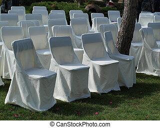 White chairs in a garden banquet