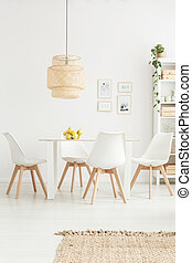 White chairs in bright room