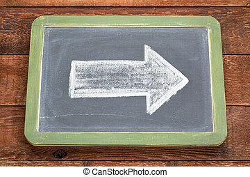 white chalk arrow on blackboard
