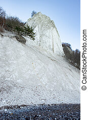 White chalk cliffs on shore of the Baltic Sea. Soft chalky does not resist to weather erosion. The island Ruegen, Germany.