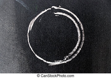 White chalk drawing in circle shape on black board background