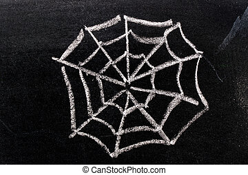 White chalk hand drawing in spiderweb shape on blackboard background
