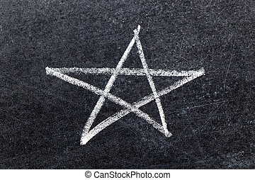 White chalk hand drawing in star shape on black board background