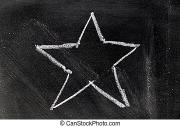 White chalk hand drawing in star shape on blackboard background