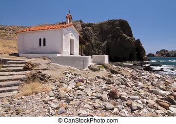 Chapel - White Chapel on a rocky beach next to the sea