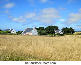 White charming house in field at French countryside. Brittany, France.