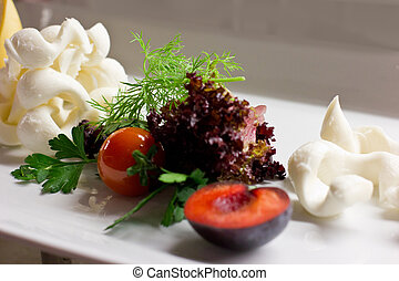 White cheese with fresh herbs, mint, plum and cherry tomatoes
