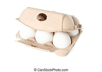 White chicken eggs in carton box isolated on white background