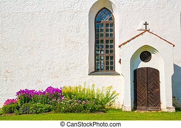 White chirch wall with window and door