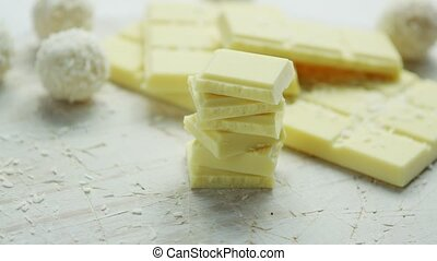 White chocolate and sweets - Bar of white chocolate with...