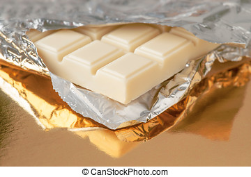 white chocolate bar on gold base and silver
