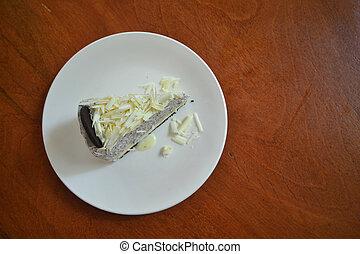 White chocolate cheesecake on a white plate
