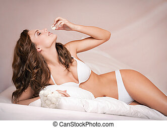 White chocolate fun. - Portrait of a gorgeous young brunette...