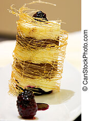 White chocolate naranja tower topped with berries.