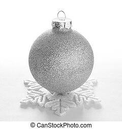 White Christmas Ball and Decorative Snowflake on the White...