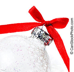 White Christmas Ball with Red Ribbon on a snow on white backgrou