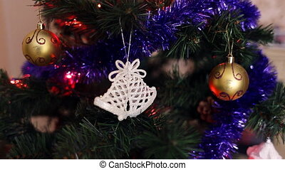 White christmas bell on tree