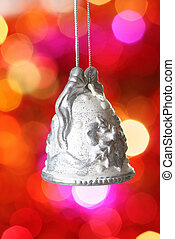 Christmas bell with silver pattern against blurred background
