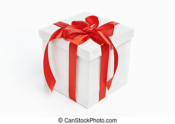 White Christmas present with red ribbon