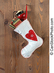 White Christmas stocking on an old door.