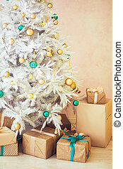 White Christmas tree and Christmas gifts in craft paper