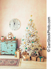 White Christmas tree and Christmas gifts in light room, turquois dresser and clock on the wall