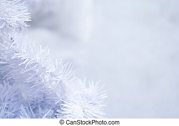 White Christmas tree background with blurred snow effect