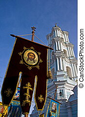 White church belfry and blue gonfa
