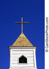 White Church - White clapboard church bell tower topped with...