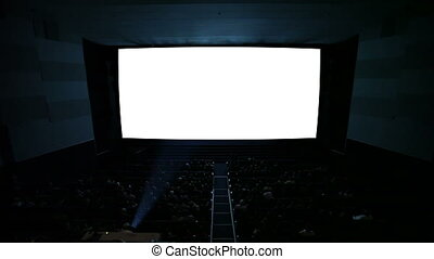 White cinema screen with projector light and audience in a modern cinema house. The most powerful shot in my cinema screen collection. Quite ready to add your video.