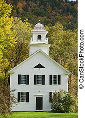 White clapboard church in New England, with a steeple.