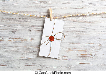 White classic envelope hanging on twine rope