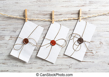 White classic envelopes hanging on twine rope