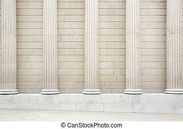 White classical columns and wall